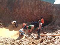 Miners panning for gold in Uganda