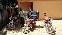 Quick bodaboda transfer of stuff in Entebbe, Uganda