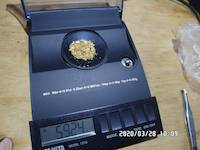 2020-03-28, 5.924 grams of natural gold nuggets on the balance scale