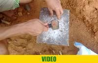 Crushing rocks with hammer on a metallic surface