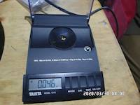 2020-03-30, 0.046 grams of natural gold nuggets on the balance scale