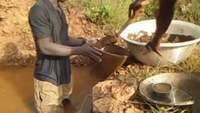 Small scale miners panning gold in Ghana