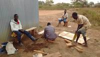 Workers preparing the improvized wooden table