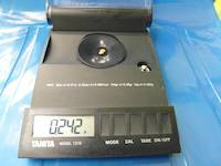 0.242 grams of gold nugget on the scale