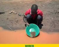 Mr. Tibasima, gold panning for gold at river Okame, near Amonikakinei, Uganda