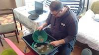 Mr. Dejan learning gold panning