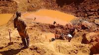 Miners working on the open pit
