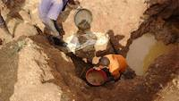 Miners searching for rich gold ore
