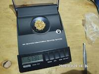 2020-03-28, 5.738 grams of natural gold nuggets on the balance scale