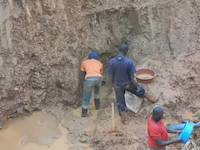 Miners in Uganda trying to get to the rich ore vein