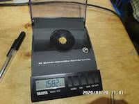 2020-03-28, 1.582 grams of natural gold nuggets on the balance scale