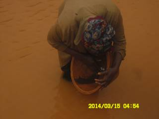 Miner panning for gold in Ghana