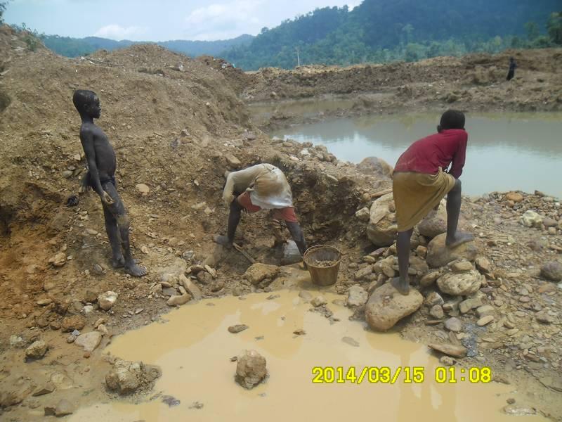 Children washing surplus ore for gold
