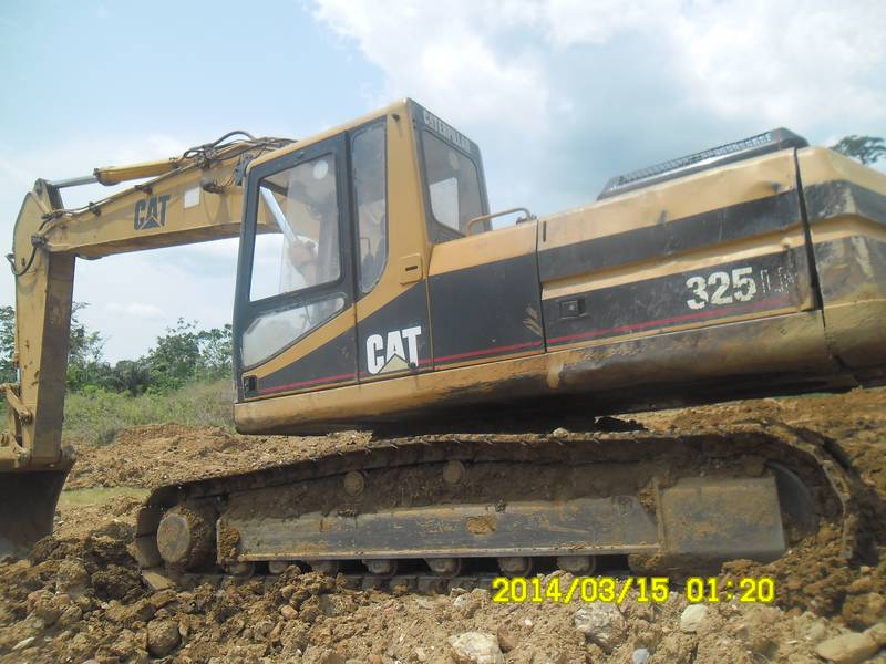 Excavator Caterpillar 325 on mining site in Ghana