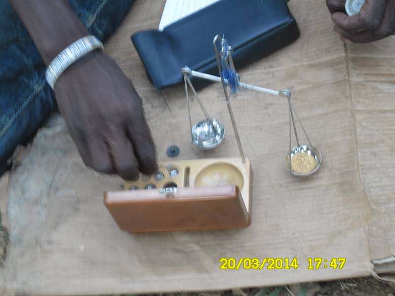 Gold broker purchasing gold directly on the mining site in Ghana