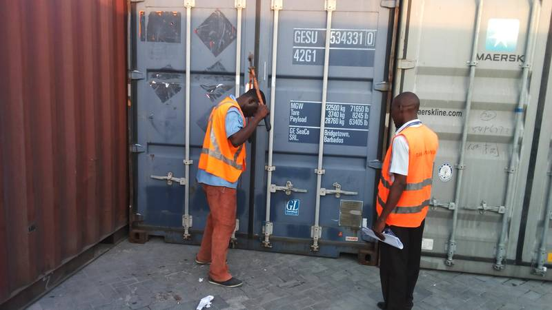 Port's employees opening the container