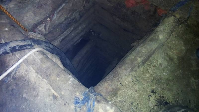 With timber secured mining shaft