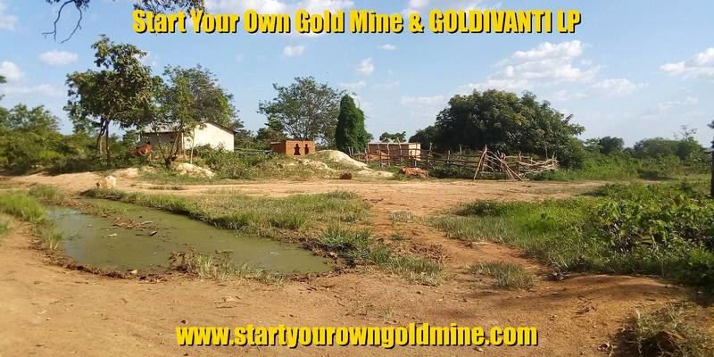 Artisanal mining site and pond of water