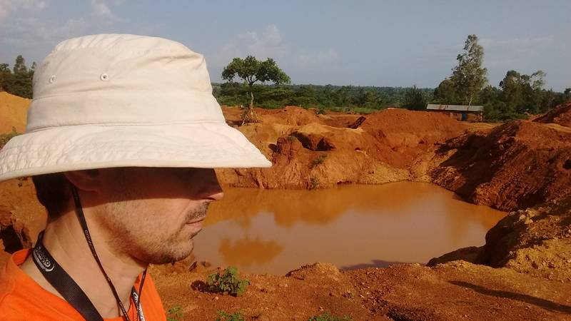 Mr. Louis with open pit in background