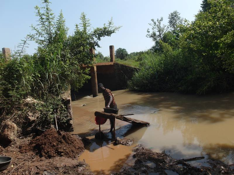 Person processing soil on the river Okame in Uganda
