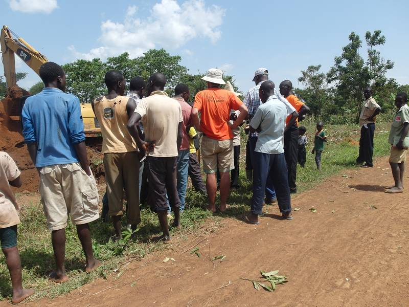 Talking with local farmers and miners