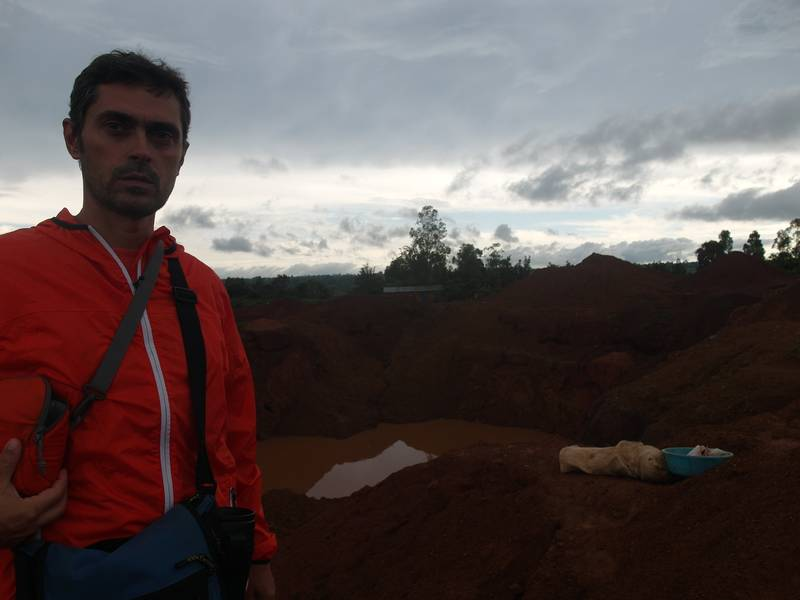 Mr. Louis in front of the open pit