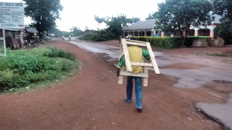 Wooden goat being transported to headquarter