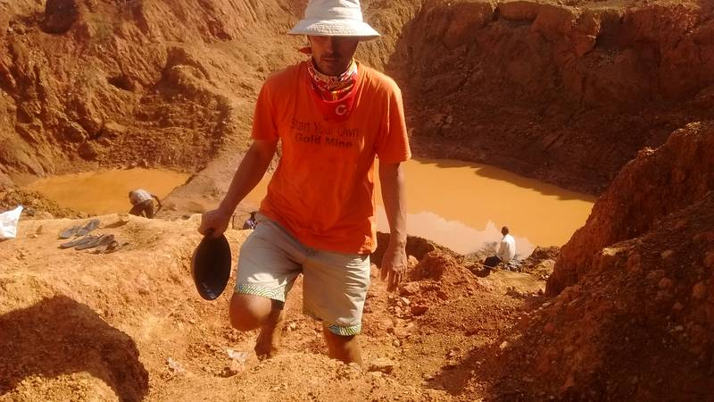 Mr. Jean Louis prospecting on the open pit