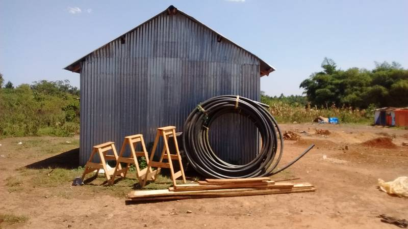 Wooden goats, the HDPE pipe and timber on the site