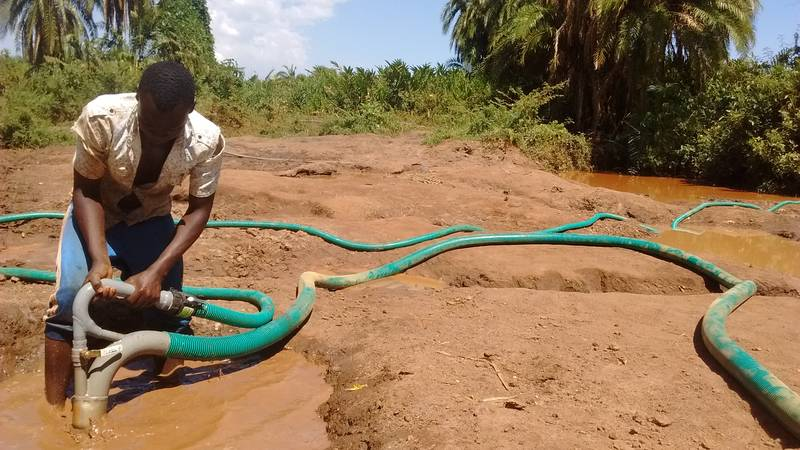 Miner working with hydro-nozzle in Uganda