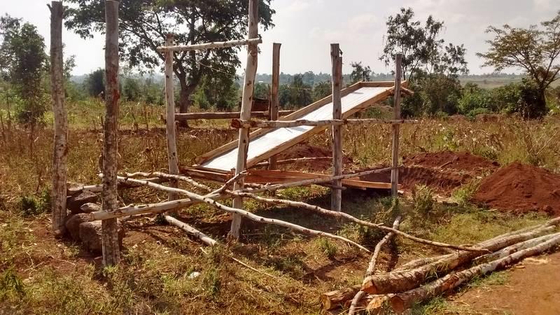 Preparation of rudimentary sluice for ore processing in Uganda