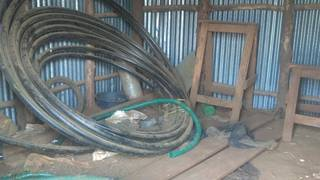 HDPE pipes and wooden goats in the storage room