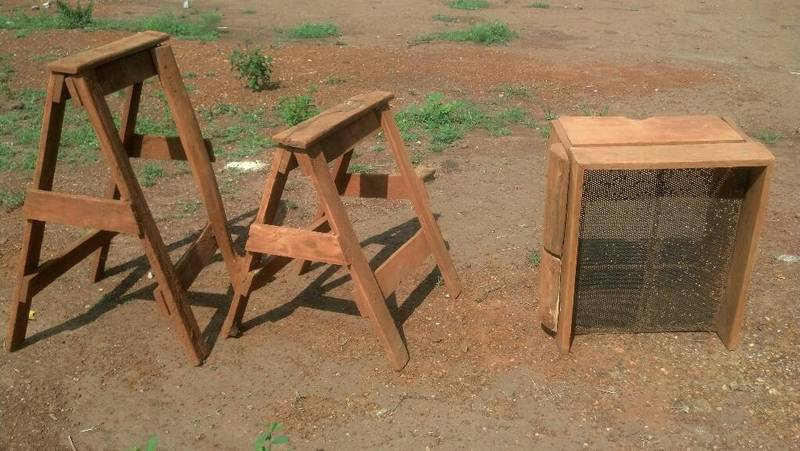 Wooden goats and basic sluice feeder with the perforated metal sheet