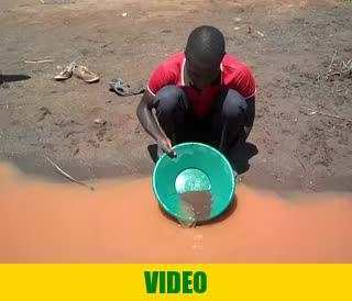 Mr. Tibasima, gold panning for gold at river Okame, near Amonikakinei, Uganda