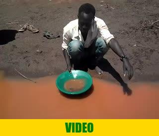 Mr. Okedi, gold panning in Amonikakinei, Uganda