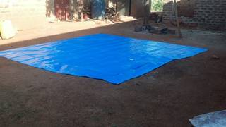 The square plastic canvas prepared on ground for sample mixing