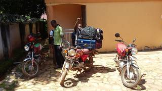 Quick bodaboda transfer of stuff in Entebbe, Uganda