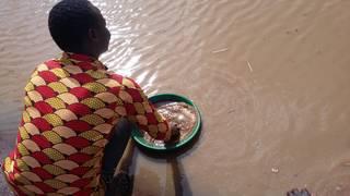 Wabwire gold panning on river Okame, Busia, Uganda