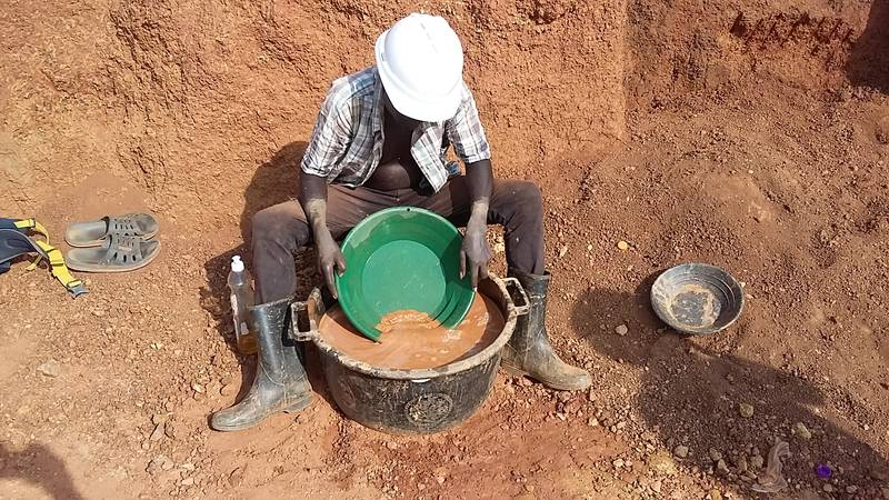 Mr. Okedi prospecting for gold on the open pit near Amonikakinei, Tiira, Busia, Uganda