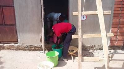 Staff members in Uganda are preparing the concentrate samples