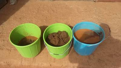 Sampling buckets contain gold concentrates