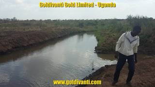 Gold prospecting on river in Northern Uganda