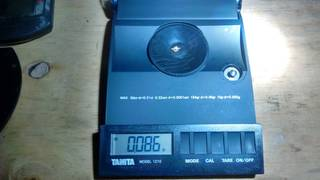 2020-03-20, 0.086 grams of natural gold nuggets on the balance scale