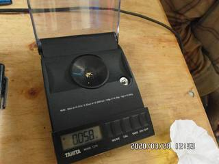 2020-03-28, 0.058 grams of natural gold nuggets on the balance scale