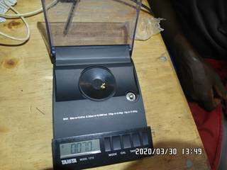2020-03-30, 0.070 grams of natural gold nuggets on the balance scale