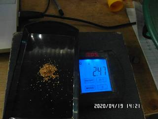 2.47 grams of the gold on the balance scale