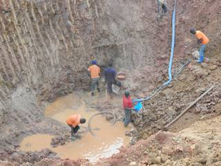 Miners working hard to reach the rich gold ore vein